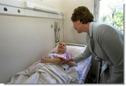 Laura Bush visits a patient in an oncology clinic in Budapest, Hungary, May 17, 2002.  White House photo by Susan Sterner