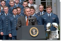 "President George W. Bush speaks during the presentation of the Commander-in-Chief's Trophy to the Air Force Academy football team in the Rose Garden Friday, May 17. ""During last May's visit, I said of Coach DeBerry, he is not just recruiting to win football games, he is recruiting to win our nation's war, if we have one. That was May. And on September 11th, war came to our country. And I want to thank you, Coach, for recruiting those who will help us win our nation's wars,"" remarked the President. White House photo by Tina Hager."