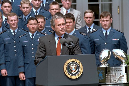 "President George W. Bush speaks during the presentation of the Commander-in-Chief's Trophy to the Air Force Academy football team in the Rose Garden Friday, May 17. ""During last May's visit, I said of Coach DeBerry, he is not just recruiting to win football games, he is recruiting to win our nation's war, if we have one. That was May. And on September 11th, war came to our country. And I want to thank you, Coach, for recruiting those who will help us win our nation's wars,"" remarked the President."