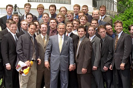 President George W. Bush poses with NCAA champions, the University of Minnesota men's basketball team, on the South Lawn May 21. White House photo by Tina Hager.