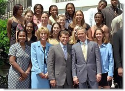 President George W. Bush poses with NCAA champions, the University of Connecticut's women's basketball team, on the South Lawn May 21. White House photo by Tina Hager.