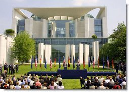 President George W. Bush answers questions during a press conference with German Chancellor Gerhard Schroeder in the courtyard of the Kanzleramt-Chancellery Building in Berlin, Germany, Thursday, May 23. White House photo by Paul Morse.