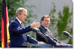 President George W. Bush and German Chancellor Gerhard Schroeder participate in a press conference in the courtyard of Kanzleramt-Chancellery Building in Berlin, Germany, Thursday, May 23. White House photo by Paul Morse.