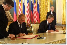 President George W. Bush and Russian President Vladimir Putin sign an arms reduction treaty at the Kremlin in Moscow, Russia on May 24, 2002. White House photo by Paul Morse.