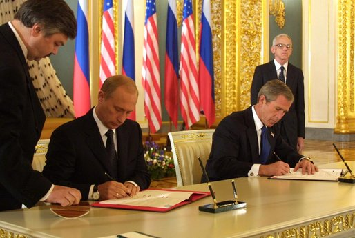 President George W. Bush and Russian President Vladimir Putin sign an arms reduction treaty at the Kremlin in Moscow, Russia on May 24, 2002.