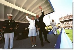 After speaking at the United States Naval Academy commencement, Vice President Dick Cheney waves with a graduate to her family in the stadium May 24, 2002.  White House photo by David Bohrer