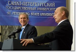 President George W. Bush laughs at a comment by Russian President Vladimir Putin during a question and answer session with students at St. Petersburg State University in St Petersburg, Russia on May 25, 2002. White House photo by Paul Morse.
