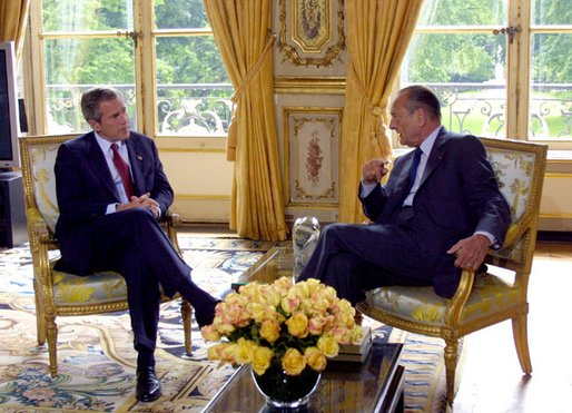 President George W. Bush talks with French President Jacques Chirac after arriving at the Elysee Palace in Paris, France on May 26, 2002. White House photo by Paul Morse.