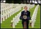 President George W. Bush gives a Memorial Day at the Normandy American Cemetery at Normandy Beach in France on May 27, 2002.