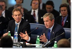 President George W. Bush address world leaders with British Prime Minister Tony Blair next to him during the meeting of the NATO-Russia Council at Practica di Mare Air Force base near Rome, Italy on May 28, 2002.