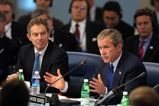 President George W. Bush address world leaders with British Prime Minister Tony Blair next to him during the meeting of the NATO-Russia Council at Practica di Mare Air Force base near Rome, Italy on May 28, 2002. President George W. Bush address world leaders with British Prime Minister Tony Blair next to him during the meeting of the NATO-Russia Council at Practica di Mare Air Force base near Rome, Italy on May 28, 2002.