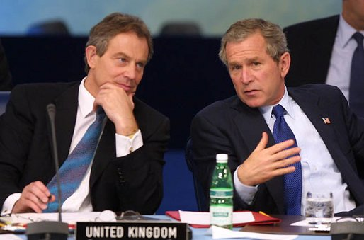 President George W. Bush chats with British Prime Minister Tony Blair during the meeting of the NATO-Russia Council at Practica di Mare Air Force base near Rome, Italy on May 28, 2002 White House photo by Paul Morse. President George W. Bush chats with British Prime Minister Tony Blair during the meeting of the NATO-Russia Council at Practica di Mare Air Force base near Rome, Italy on May 28, 2002 White House photo by Paul Morse.