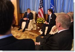 President George W. Bush with NATO Secretary General Lord Robinson at Practica di Mare Air Force base Near Rome, Italy on May 28, 2002. White House photo by Paul Morse.