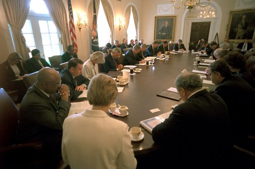 "President George W. Bush prays with his Cabinet at the beginning of their meeting May 30. ""This a day in which we've removed all the debris from Ground Zero. On behalf of a grateful nation, I want to thank all those who participated in the clean up of that deadly site; and want our nation to continue to offer our prayer to those families and friends and citizens who still hurt as a result of the attacks of September the 11th."" White House photo by Eric Draper."
