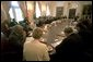 "President George W. Bush prays with his Cabinet at the beginning of their meeting May 30. ""This a day in which we've removed all the debris from Ground Zero. On behalf of a grateful nation, I want to thank all those who participated in the clean up of that deadly site; and want our nation to continue to offer our prayer to those families and friends and citizens who still hurt as a result of the attacks of September the 11th."""