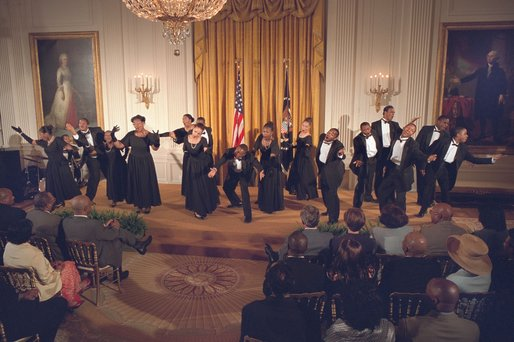 "The Show Choir from the Duke Ellington School of the Arts performs for President George W. Bush at the Celebration of African American Music, History, and Culture in the East Room May 28. ""The music and culture of Black Americans has brought great beauty into this world. Today it brings great pride to our country,"" said the President. White House photo by Eric Draper."