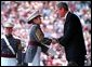 President Bush presents a diploma to a United States Military Academy graduate at West Point, N.Y. Saturday, June 1.