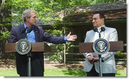 President George W. Bush speaks during a press conference with Egyptian President Hosni Mubarak after their meeting at Camp David, Saturday, June 8. President Bush said