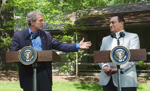 "President George W. Bush speaks during a press conference with Egyptian President Hosni Mubarak after their meeting at Camp David, Saturday, June 8. President Bush said ""We spent time talking about the Middle East and we share a common vision of two states living side by side in peace. And I appreciated so very much listening to his ideas as to how to achieve that objective."" White House photo by Eric Draper."
