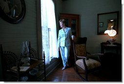 Laura Bush walks through the home of author Katherine Anne Porter in Kyle, Texas, June 13, 2002.  White House photo by Tina Hager
