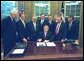 President George W. Bush signs the Export-Import Bank Reauthorization Act in the Oval Office June 14, 2002.
