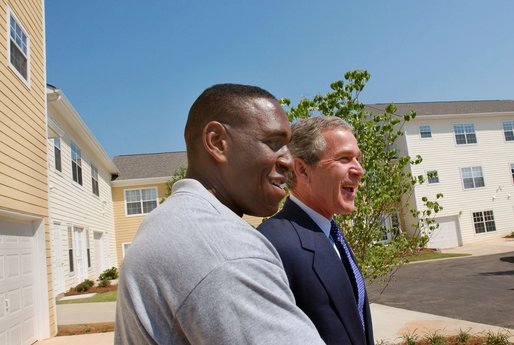 President George W. Bush and new home owner Al Smith tour Pryor Road Corridor Development in Atlanta, Georgia, Monday, June 17. White House photo by Eric Draper.