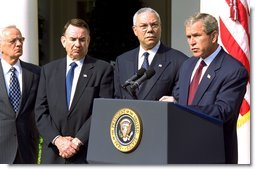 "President George W. Bush announces a new Mother and Child HIV Prevention Initiative in the Rose Garden June 19. Standing by the President from, left to right, are Secretary of Treasury Paul O'Neill, Secretary of Health and Human Services Tommy Thompson and Secretary of State Colin Powell. ""Today I announce that my administration plans to make $500 million available to prevent mother-to-child transmission of HIV,"" said the President. ""This new effort, which will be funded during the next 16 months, will allow us to treat one million women annually, and reduce mother-to-child transmission by 40 percent within five years or less in target countries. White House photo by Tina Hager."