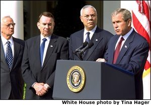 President George W. Bush announces a new Mother and Child HIV Prevention Initiative in the Rose Garden June 19. Standing by the President from, left to right, are Secretary of Treasury Paul O'Neill, Secretary of Health and Human Services Tommy Thompson and Secretary of State Colin Powell.