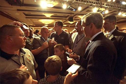 President George W. Bush meets with the delegates and their families during his visit to the United Brotherhood of Carpenters and Joiners of America 2002 Legislative Conference in Washington, D.C., Wednesday, June 19.