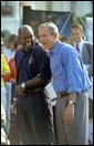 President George W. Bush takes in the excitement of the White House Fitness Expo on the South Lawn with Dallas Cowboys Running Back Emmitt Smith June 20.