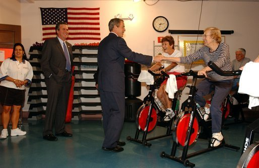 "Accompanied by the Governor of Florida, his brother Jeb Bush, President George W. Bush visits senior citizens participating in an aerobic ""spinning class"" at the Marks street Senior Recreation Complex in Orlando, Fla., Friday, June 21, 2002. White House photo by Tina Hager."