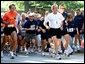 President George W. Bush competes in the 3 mile run as part of The President's Fitness Challenge at Ft. McNair on Saturday June 21, 2002.