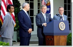 President George W. Bush discusses his plan for peace in the Middle East as Dr. Condoleezza Rice (left), Sec. Colin Powell (center) and Sec. Donald Rumsfeld stand by his side in the Rose Garden Monday June 24. White House photo by Paul Morse.