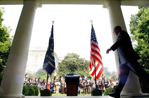 President George W. Bush approaches the podium to unveil his plan for the Middle East during a Rose Garden press conference Monday June 24. White House photo by Eric Draper.