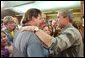 President George W. Bush greets familes displaced by the Arizona forest fires at Round Valley High School in Eagar, Ariz., Tuesday, June 25. White House photo by Eric Draper.