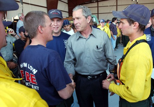 President George W. Bush greets members of the fire deparment in Show Low, Ariz., during his visit to the forest fire area in Springerville, Ariz., Tuesday, June 24.