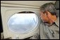 President George W. Bush looks out the window of Air Force One during an aerial tour of the forest fires over Springerville, Ariz., Tuesday, June 25. White House photo by Eric Draper.