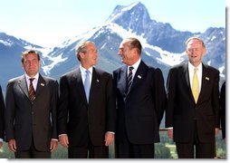 President George W. Bush and other G8 leaders pose for photographers during the photo session at the G8 Summit in Alberta, Canada, June 26. Pictured the President from left are German Chancellor Gerhard Schroeder, French President Jacques Chirac and Canadian Prime Minister Jean Chretien. White House photo by Eric Draper.