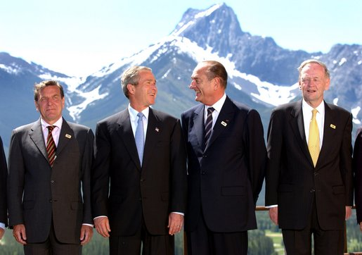 President George W. Bush and other leaders at the G8 Summit in Alberta, Canada, June 26. Pictured with the President from left are German Chancellor Gerhard Schroeder, French President Jacques Chirac and Canadian Prime Minister Jean Chretien. White House photo by Eric Draper.