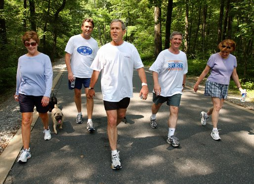 President George W. Bush and First Lady Laura Bush complete a four mile walk with brother Marvin Bush, left, Chief of Staff Andy Card and wife Kathleene after undergoing a colorectal screening procedure at Camp David, Saturday morning, June 29. White House photo by Eric Draper.