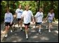 President George W. Bush and First Lady Laura Bush complete a four mile walk with brother Marvin Bush, left, Chief of Staff Andy Card and wife Kathleene after undergoing a colorectal screening procedure at Camp David, Saturday morning, June 29. White House photo by Eric Draper