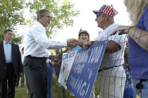 President George W. Bush greets residents of Ripley, West Virginia moments after his arrival on Marine One, July 4. White House photo by Eric Draper.