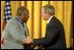 "President George W. Bush presents the Presidential Medal of Freedom to baseball legend Henry Aaron during a ceremony at the White House, July 9, 2002. ""The Presidential Medal of Freedom is the highest civil honor our nation can bestow. And we award it today to 12 outstanding individuals,"" said the President. ""The men and women we honor span the spectrum of achievement. Some are fighters; others are healers; all have left an enduring legacy of hope and courage and achievement."" White House photo by Eric Draper."