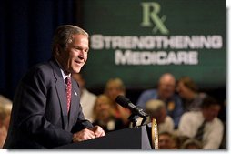 President George W. Bush remarks on improving prescription drug coverage in Minneapolis, Minn., during a full day of discussions about strengthening America's Medicare system Thursday, July 11. White House photo by Paul Morse.