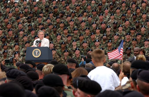 President George W. Bush addresses troops and families of the 10th Mountain Division and other members of the Fort Drum Community at Fort Drum, N.Y., July 19, 2002 White House Photo by Tina Hager White House photo by Tina Hager.
