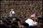 President George W. Bush addresses troops and families of the 10th Mountain Division and other members of the Fort Drum Community at Fort Drum, N.Y., July 19, 2002 White House Photo by Tina Hager