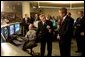 President George W. Bush listens to Hermann Grunder, Director of the Argonne National Laboratory, during a tour of the research facilities with Homeland Security Director Tom Ridge, Secretary of Energy Spencer Abraham and Speaker of the House of Representatives Dennis Hastert, R-IL., in Argonne, IL., July 22. Sponsored by the Dept. of Energy and operated by the University of Chicago, the laboratory is combating terrorism through innovative projects such as detectors for neutrons, biological and chemical agents and developing an emergency response system that coordinates various technologies.