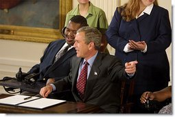 President George W. Bush reacts to the audience during the signing of the proclamation that marks the 12th Anniversary of the Americans with Disabilities Act in the East Room Friday, July 26. White House photo by Paul Morse.
