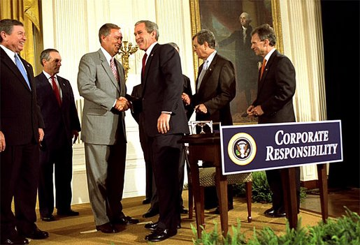 "President George W. Bush shakes hands with Congressman Mike Oxley, R-OH, during the signing of the ceremony of the Sarbanes-Oxley Act in the East Room, July 30. ""This new law sends very clear messages that all concerned must heed. This law says to every dishonest corporate leader: you will be exposed and punished; the era of low standards and false profits is over; no boardroom in America is above or beyond the law,"" said the President in his remarks."