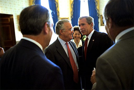 Before the signing ceremony of the Sarbanes-Oxley Act, President George W. Bush meets with Sen. Paul Sarbanes, D-Md., Secretary of Labor Elaine Chao and other dignitaries in the Blue Room at the White House July 30.